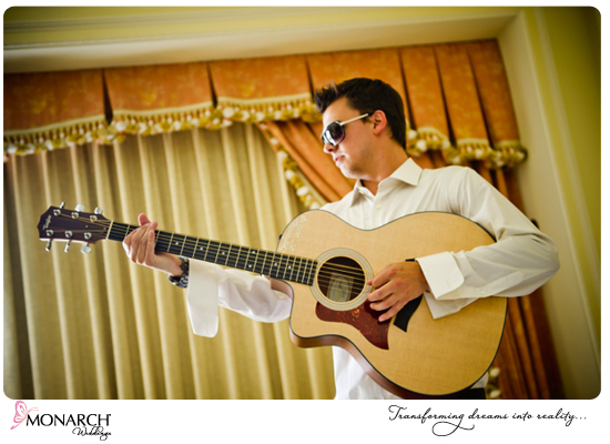 Groomsmen-with-guitar-Westgate-hotel
