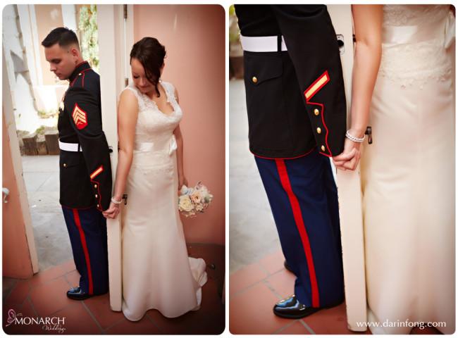 Bride-and-groom-behind-door-secret-hand-holding-la-valencia-hotel-wedding