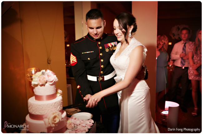 Blush-black-white-wedding-at-La-Valencia-Cake-cutting-military-knife