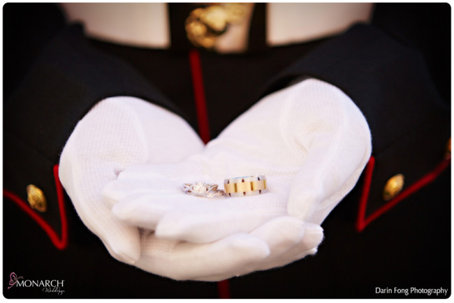 Marine-white-gloves-holding-wedding-bands-la-valencia-wedding