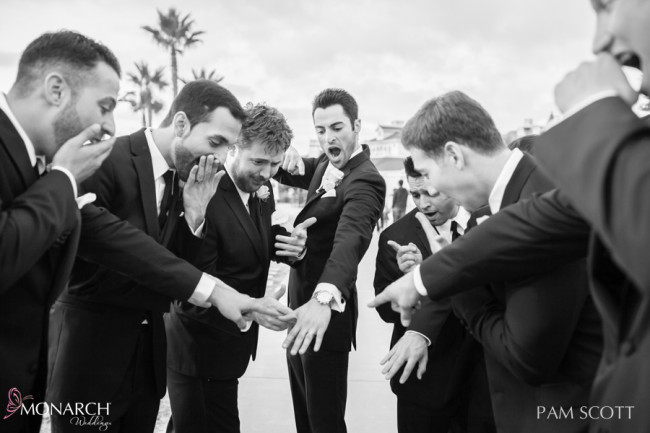 Groomsmen-reaction-to-Groom-wedding-band-ceremony-hotel-del-coronado-wedding