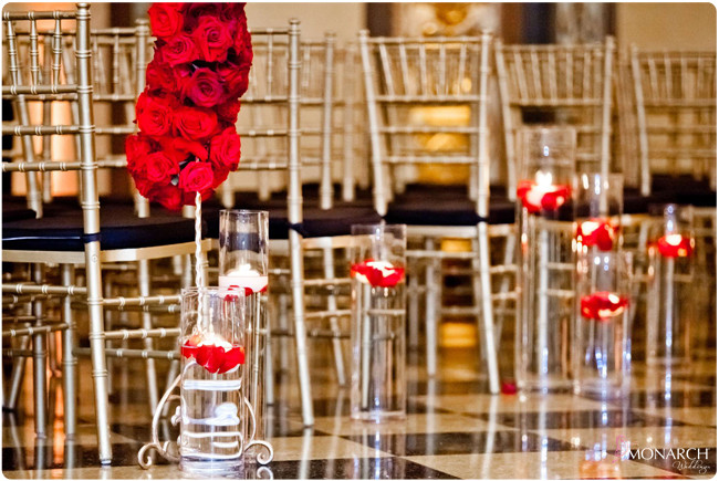 Gatsby-wedding-red-roses-floating-candles-gold-chiavari-chairs