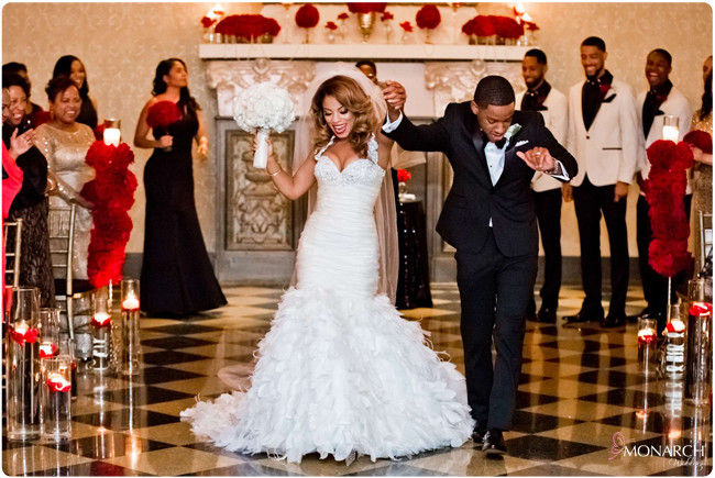 Us-Grant-Crystal-Ballroom-Bride-and-Groom-Celebrating-Red-Roses